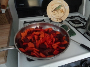 Cut slices of beets and yams cook in butter and olive oil. Simmer until soft. I didn't use any seasoning. Cool and serve.